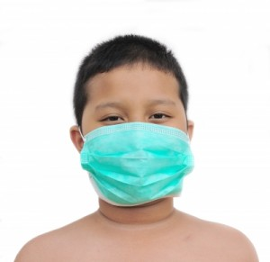 Young boy with green medical mask